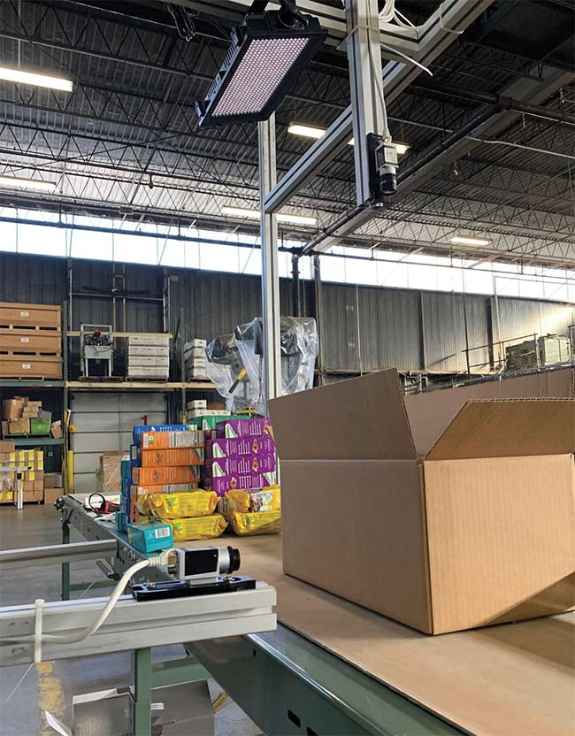 Machine learning AI vision systems use two cameras, one on the side and another above, to ensure that shipping box contents are correct. Courtesy of Evans Distribution Systems.
