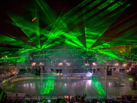 Stock image of laser show in a hockey arena.