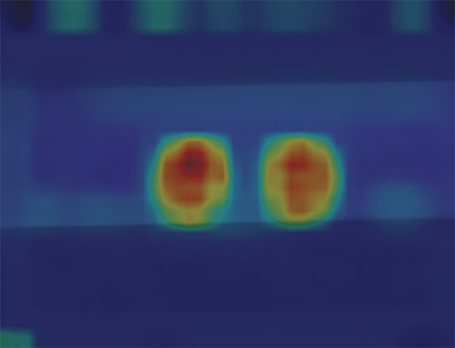Figure 3. Two defects highlighted with heat maps, which are used to pinpoint the anomaly and visually show the problem. Courtesy of Teledyne DALSA.