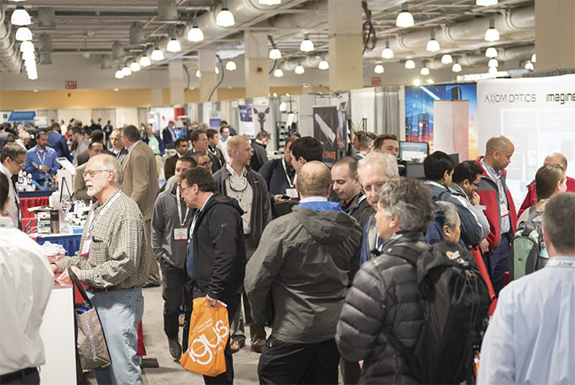 Attendees of The Vision Show 2018 browse the exhibition hall. Courtesy of AIA.