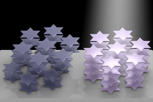 Atoms in the crystal lattice of tantalum disulfide arrange themselves into six-pointed stars that can be manipulated by light, according to Rice University researchers. The phenomenon can be used to control the material's refractive index. It could become useful for 3D displays, virtual reality and in lidar systems for self-driving vehicles. Courtesy of Weijian Li, Rice University.