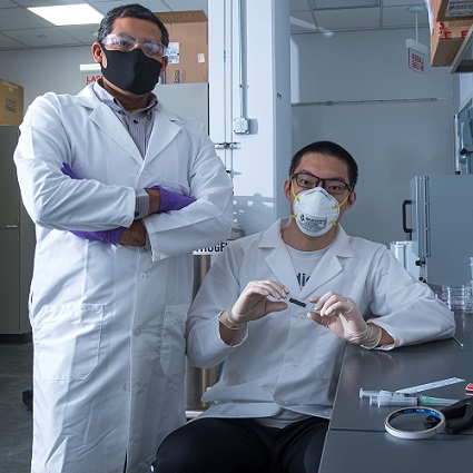 Rice University engineer Gururaj Naik and graduate student Weijian Li have discovered that 2D tantalum disulfide has unique light-handling properties that could be useful for 3D displays, virtual reality and self-driving vehicles. Courtesy of Jeff Fitlow, Rice University.