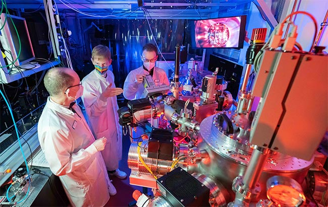 Prof. Dr Gerhard Paulus, PhD student Felix Wiesner and Dr Silvio Fuchs (from left) in a laser lab of the Institute of Optics and Quantum Electronics at the University of Jena. Courtesy of Jens Meyer, University of Jena.