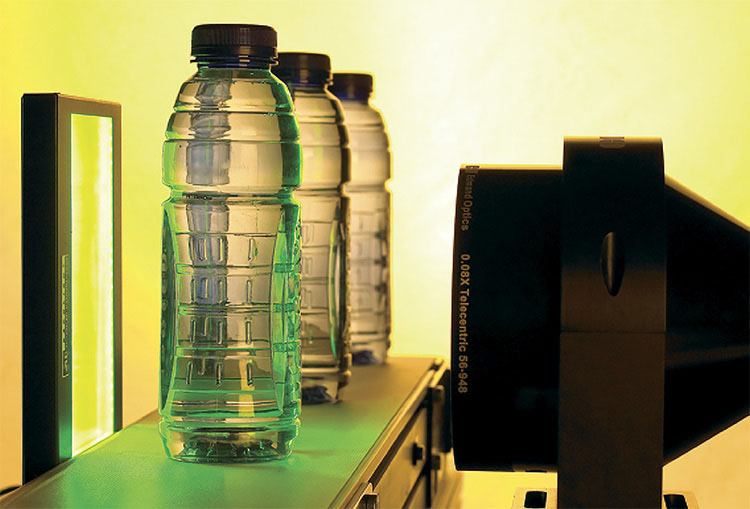 A telecentric lens and backlight illuminator used for bottle inspection. Courtesy of Edmund Optics.