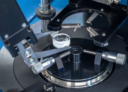 Robot-Assisted Lens Alignment